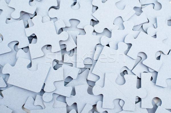 Gris piezas del rompecabezas primer plano juguete rompecabezas Foto stock © cherezoff