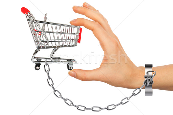 Chained hand holding shopping cart Stock photo © cherezoff