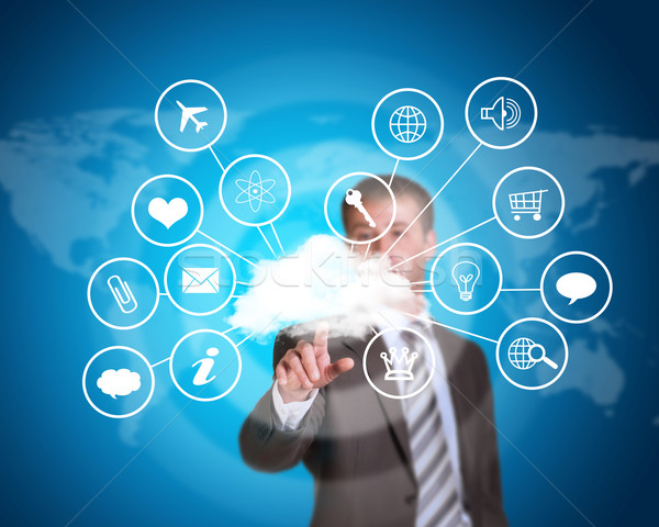 Business man pointing her finger at cloud with computer icons Stock photo © cherezoff