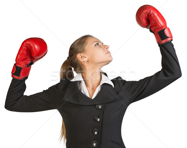 Businesswoman wearing boxing gloves, with her arms forward up Stock photo © cherezoff