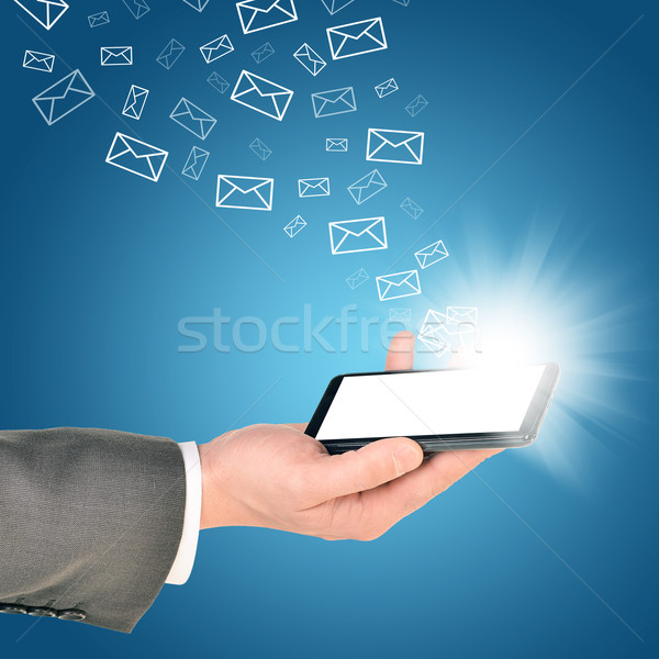 Business man using mobile phone within right hand Stock photo © cherezoff