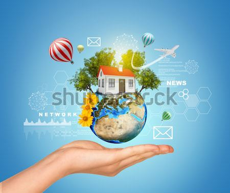 Earth with clouds above humans hands Stock photo © cherezoff