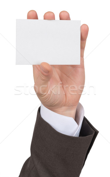 Businessman holding empty paper Stock photo © cherezoff