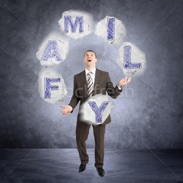 Businessman juggling word family Stock photo © cherezoff