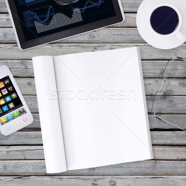 Liggen smartphone tablet Open boek business Stockfoto © cherezoff