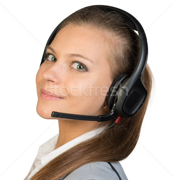 Businesswoman in headset Stock photo © cherezoff