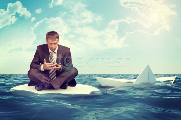 üzletember süllyed papír csónak ül lótusz Stock fotó © cherezoff