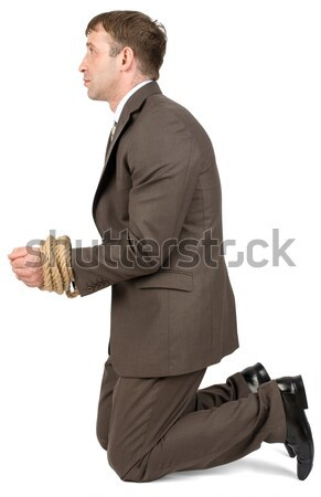 Businessman looking down on white Stock photo © cherezoff