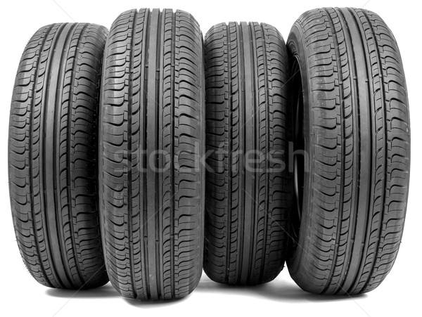Stack of four wheel new black tyres Stock photo © cherezoff