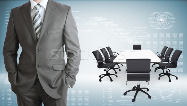 Businessman with conference table, chairs and laptops Stock photo © cherezoff