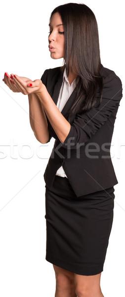 Beautiful businesswoman blowing in empty hands Stock photo © cherezoff