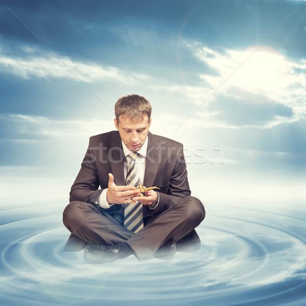Businessman in suit sitting lotus position  Stock photo © cherezoff