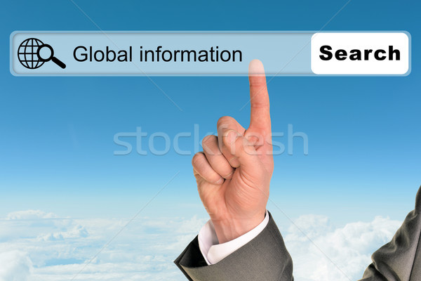 Businessmans hand on blue sky background Stock photo © cherezoff