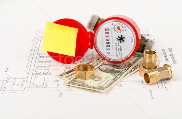 Water meter with sticker and piping components Stock photo © cherezoff