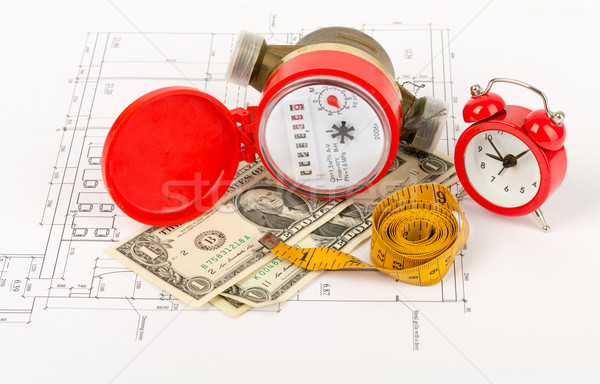Water meter with tape-measure and alarm clock Stock photo © cherezoff