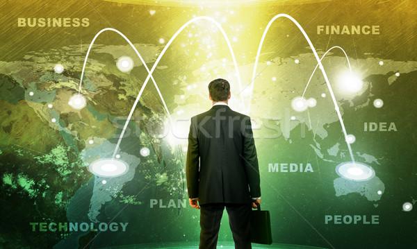 üzletember holografikus képernyő Föld földgömb üzlet Stock fotó © cherezoff