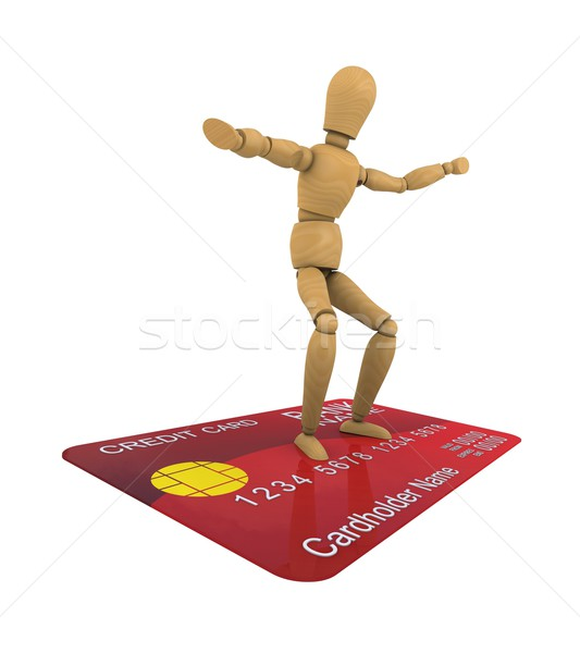 The wooden man stands on the credit card surfer pose. 3D rendering Stock photo © cherezoff