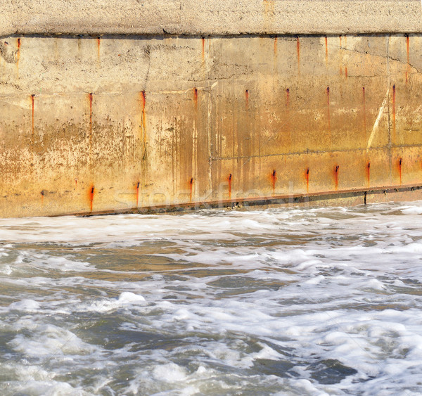 Seawater and the old concrete wall Stock photo © cherezoff