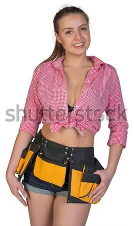 Csinos lány rövidnadrág póló szerszám öv Stock fotó © cherezoff
