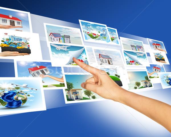 Kéz megérint holografikus képek absztrakt Stock fotó © cherezoff