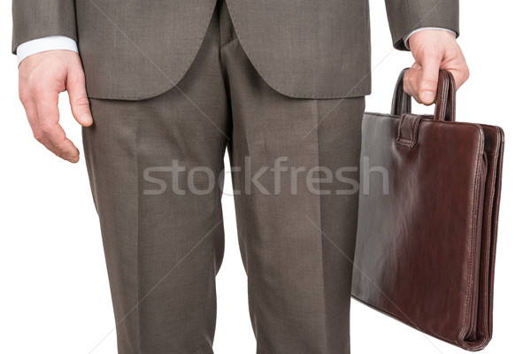 Businessman with leather suitcase Stock photo © cherezoff