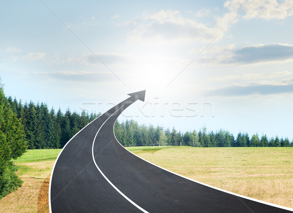 Roadway going up as an arrow in sky Stock photo © cherezoff