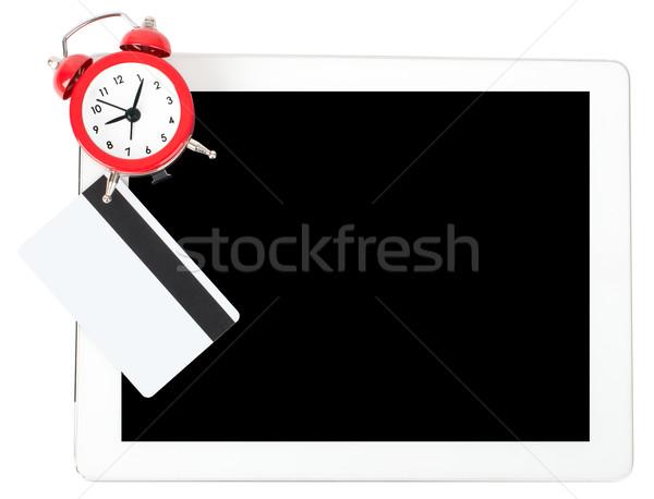 Tablet wekker geïsoleerd witte computer geld Stockfoto © cherezoff