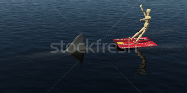 The wooden man on a credit card is floating on the water riding the shark. 3D rendering Stock photo © cherezoff