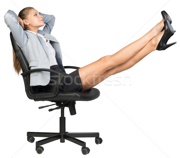 Businesswoman on office chair with her feet up Stock photo © cherezoff