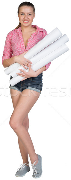 Woman holding drawing rolls Stock photo © cherezoff