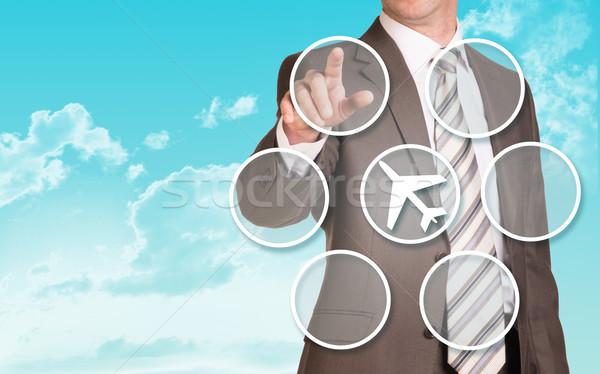 üzletember kisajtolás holografikus képernyő üres körök Stock fotó © cherezoff