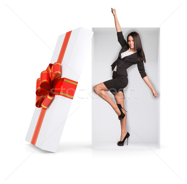 Businesswoman in winner posture inside gift box Stock photo © cherezoff