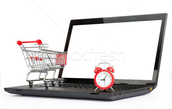 Bevásárlókocsi ébresztőóra laptop izolált fehér közelkép Stock fotó © cherezoff