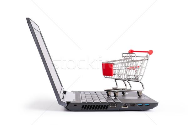 Bevásárlókocsi laptop közelkép kilátás izolált fehér Stock fotó © cherezoff