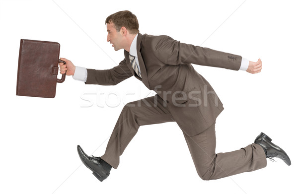 Businessman running fast with suitcase Stock photo © cherezoff