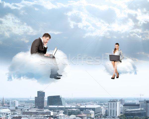 Business people working on clouds Stock photo © cherezoff