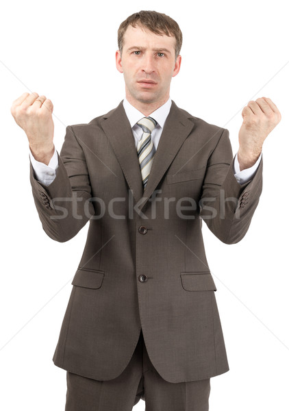 Unhappy businessman raised his hands up Stock photo © cherezoff