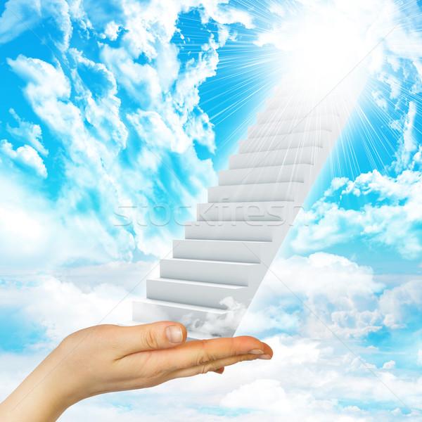 Hand hold stairs Stock photo © cherezoff