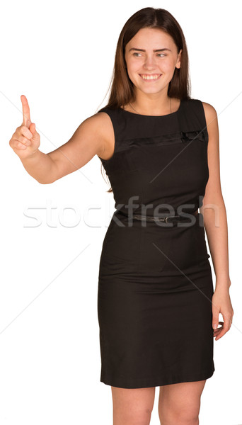 Businesswoman presses finger into empty space in front of him Stock photo © cherezoff