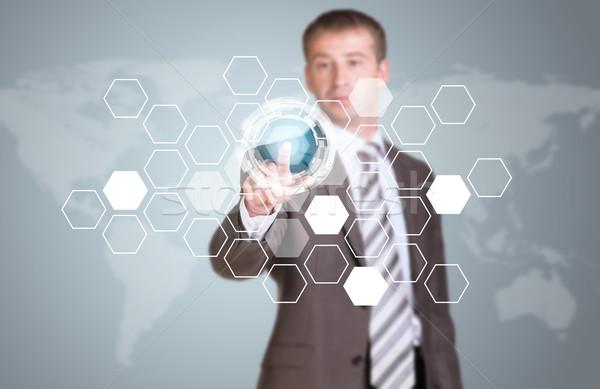 Stock photo: Businessman in suit finger presses virtual button