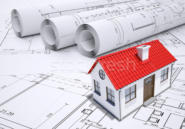 Small model house with red roof near scrolls of architectural drawings Stock photo © cherezoff