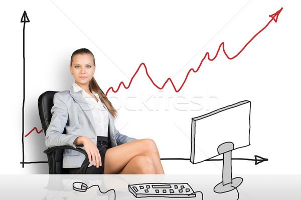 Businesslady sitting half-turned at drawn table Stock photo © cherezoff