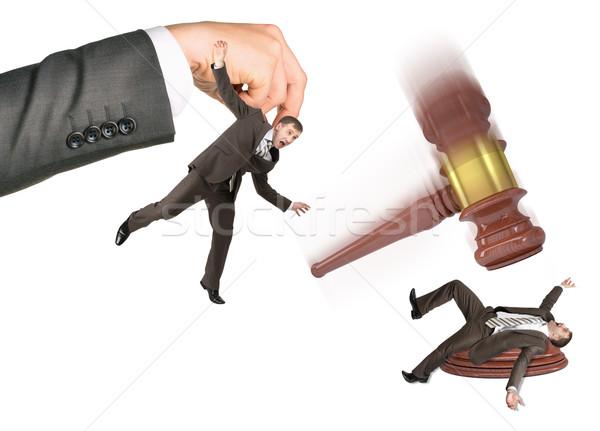 Inscribed gavel hitting businessman Stock photo © cherezoff