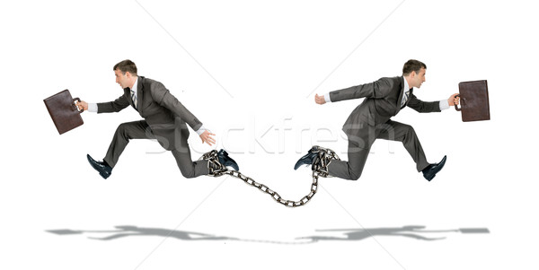 Two businessmen running in different ways Stock photo © cherezoff