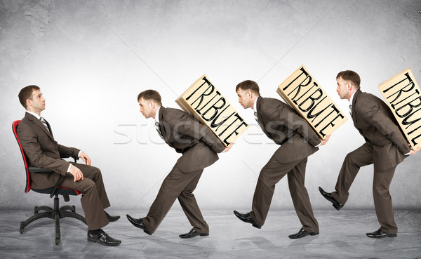 Businessmen carry boxes with word tribute Stock photo © cherezoff