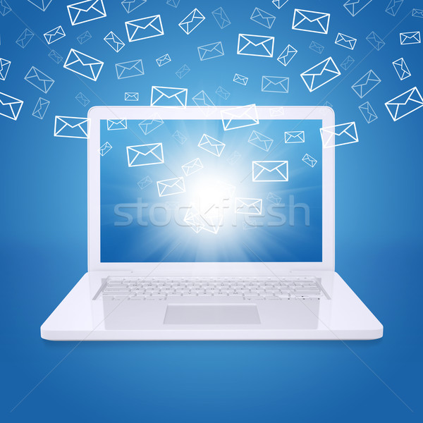 Emails fly out of laptop screen Stock photo © cherezoff