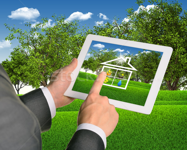 Man using tablet with symbols of public service and house Stock photo © cherezoff