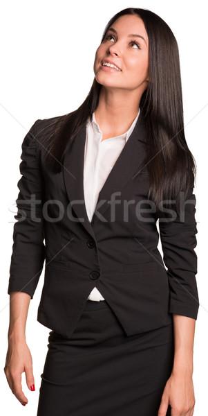 Beautiful businesswomen happily looking up Stock photo © cherezoff