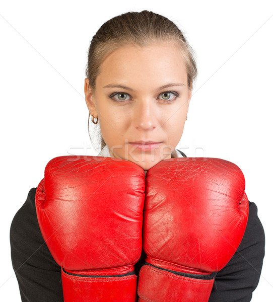 Businesswoman wearing boxing gloves Stock photo © cherezoff