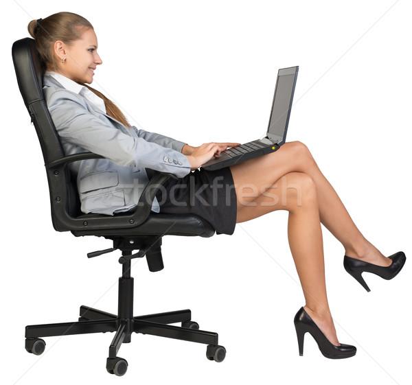 女性実業家 座って 戻る 事務椅子 ノートパソコン 見える ストックフォト © cherezoff